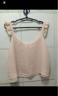 Blush ruffled top