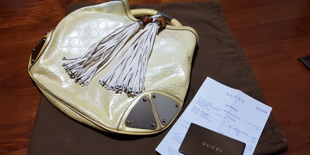 bba5db02ee4a Pre-loved Gucci Limited Edition Indy Monogram GG Babouska Top Handle ...