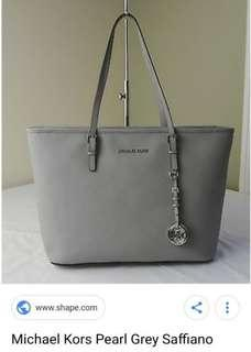 Brand New Michael Kors Jet Setter bag in icy greay