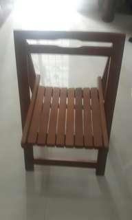 Folded brown Wooden chair