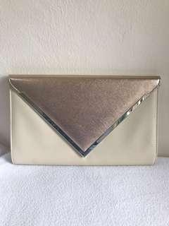 Rose gold clutch with chain strap