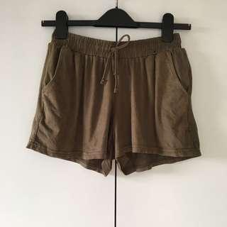 faux suede green shorts size 6