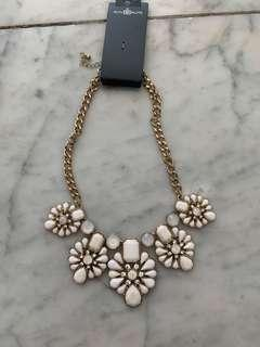 White and gold statement necklace with original tag
