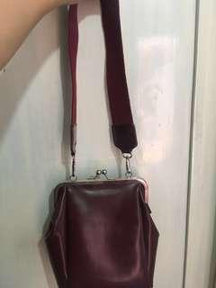 Small maroon bag
