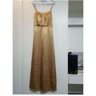 Gold prom gown with braided straps