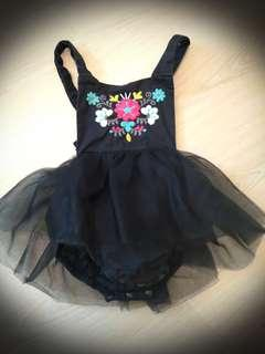 Baby girl black romper with floral embroidery