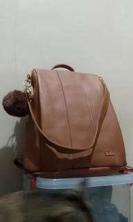 Brown anti theft backpack