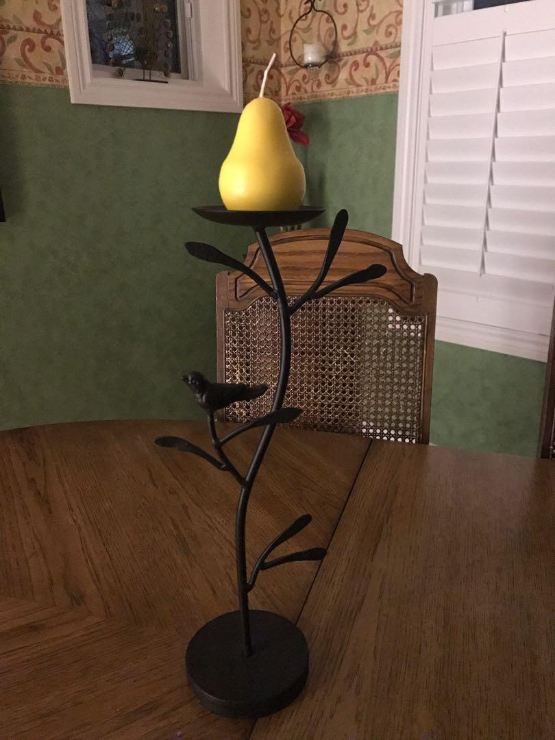 Set of black iron candlesticks with branch and bird motif