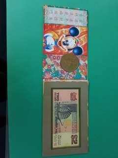 Mickey Mouse Medallion Coin and $2 Singapore ship series