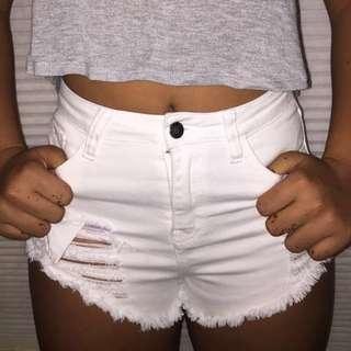 Brandy Melville High Rise Distressed Ripped Denim White Shorts