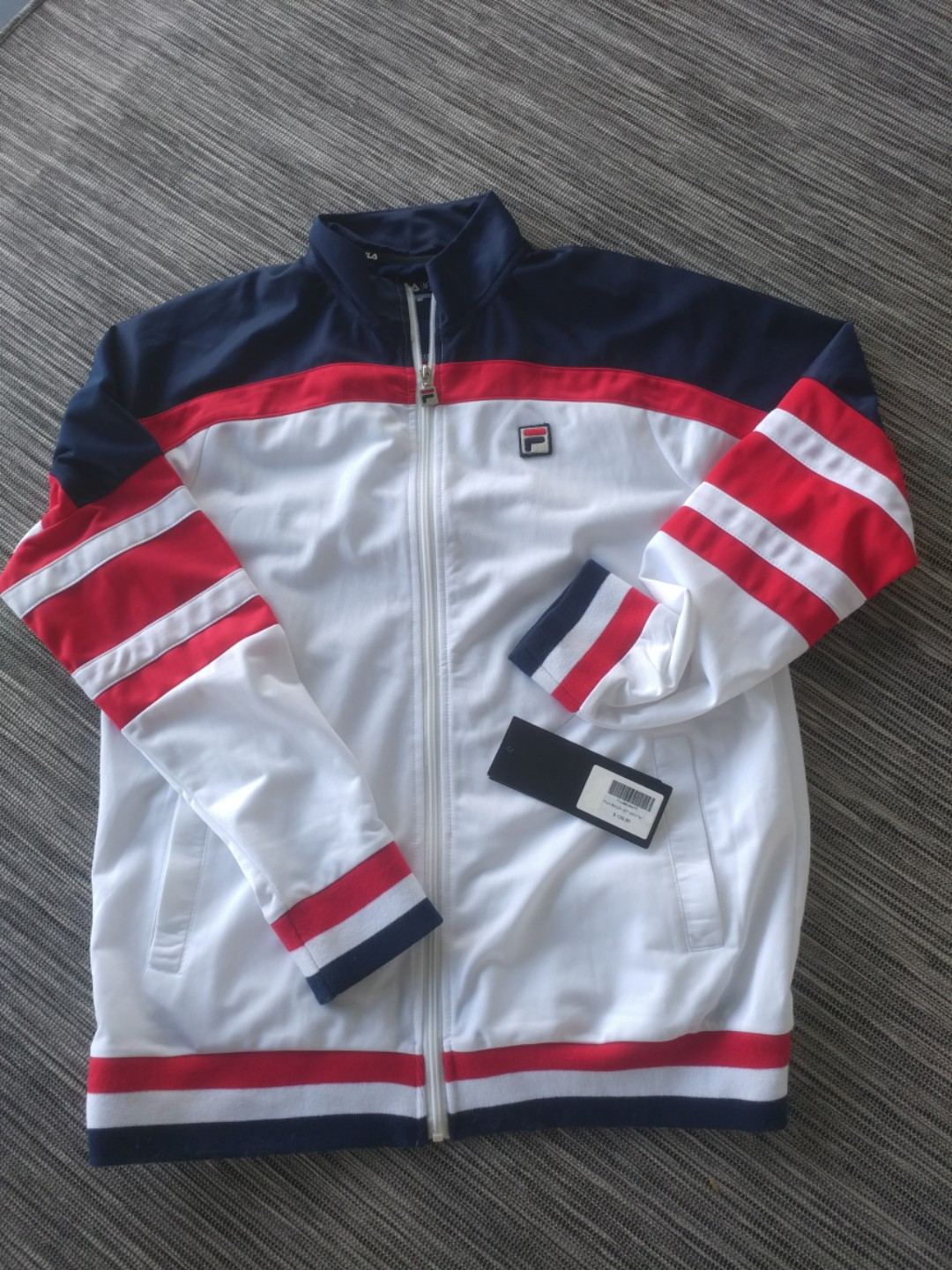 1ca156df1511 Fila track jacket, Sports, Sports Apparel on Carousell