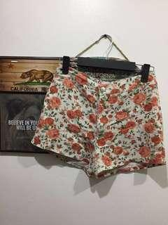 High waist orange floral shorts with leaves