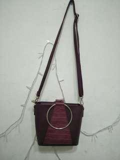 Maroon leather bag. Free makeup pouch