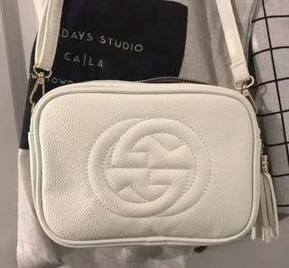 White cross over bag