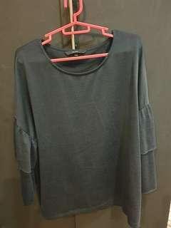 Black long sleeved ruffled blouse