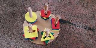 Wooden shape stacking toy