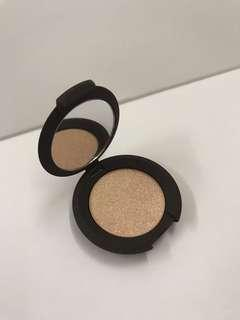 BECCA Shimmering Skin Perfector Highlighter in Champagne Pop