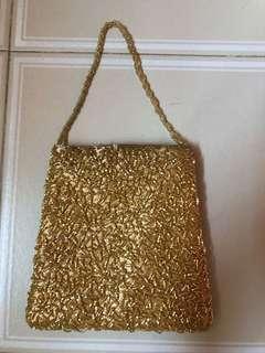 🚚 Gold dinner bag