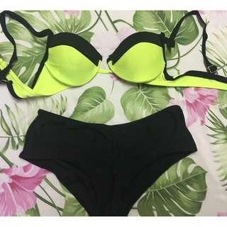 Neon bikini top and black Sassa bottom