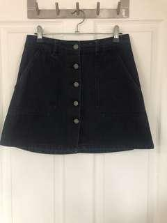 Subtitled Denim Mini Skirt
