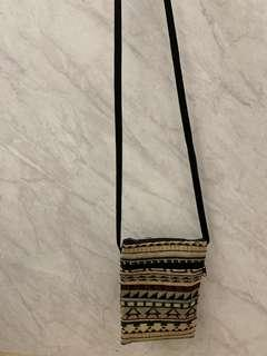 Small sling pouch with tribal prints