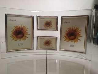 Elegant photo frame (4 slots)