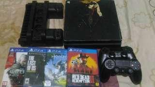 PS4 SLIM 500 GB+ games + cooling stand + 2 stick PS