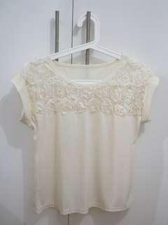 Top with flower applique