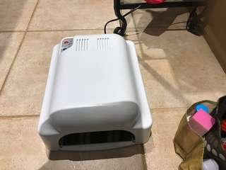 Shellac machine with led light comes with base/top coat and shellac nail polishes All for $45