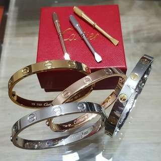 Cartier two tone screw bangles