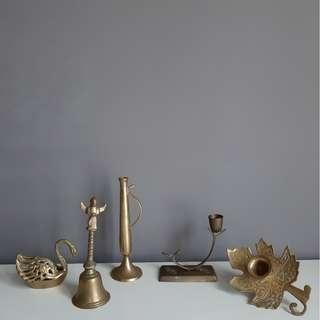 Brass candle holders, bell, and ashtray