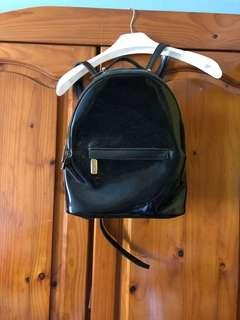 Patent black backpack