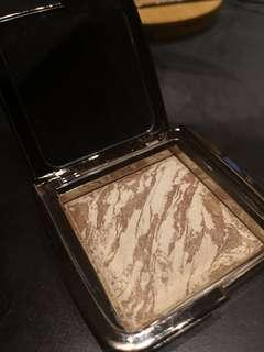 Hourglass Ambient Lighting Bronzer shade in diffused bronze light