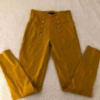 Mustard high waisted pants with button details