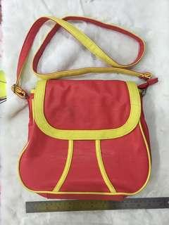 Pinkish Red with yellow shoulder bag