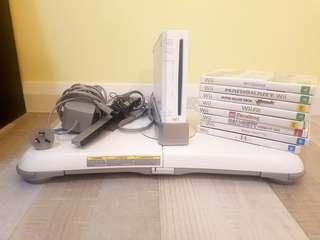 Selling Wii Console + 2 controllers, 8 games and wii fit board