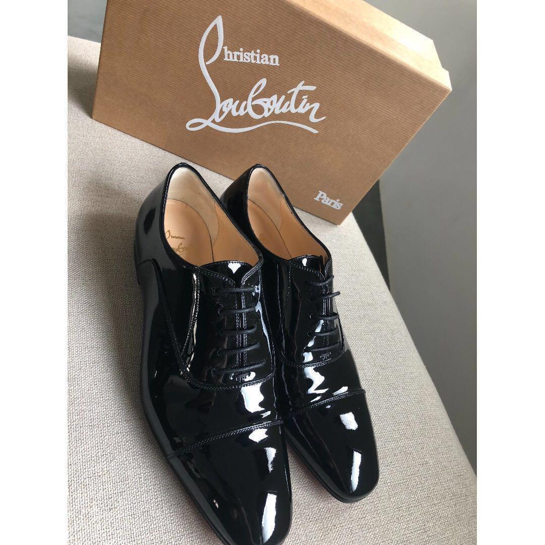Black Masterpump patent-leather brogues
