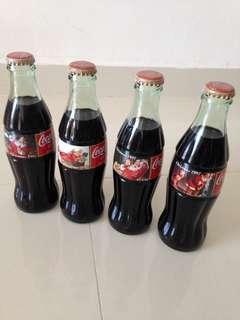 🚚 1997 Christmas Coca Cola Green Glass Bottles Set of 4 (USA) 237ml Coke