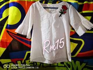 White blouse with rose patch