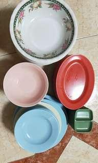 Plastic bowls, plates and chilly saucers