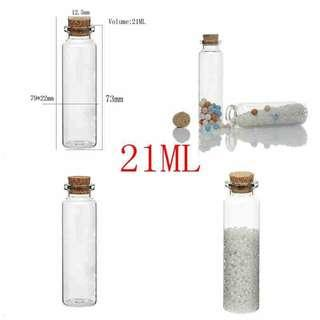 Glass cylindrical bottle with cork