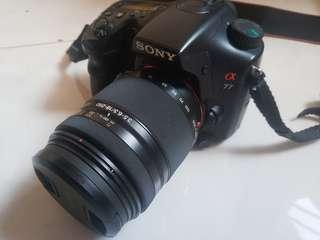 Sony A77 DSLR with zoom lens..