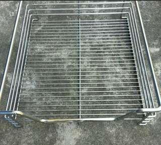 Stainless steel, very good quality,  made of thick metal wire