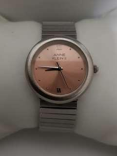 Authentic Anne Klein watch for ladies with elastic metallic stainless steel band
