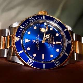 My rolex submariner watch 16613 blue face 18k yellow gold