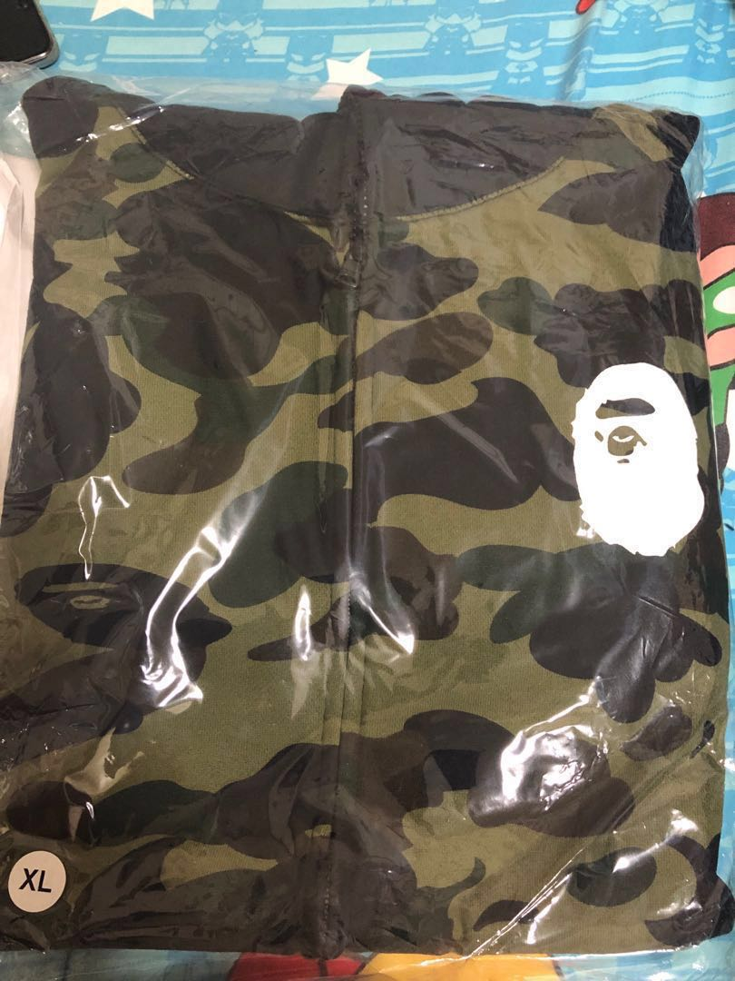 1e3faad5 Bape 1ST Camo Happy New Year Bag 2019, Men's Fashion, Clothes, Tops ...