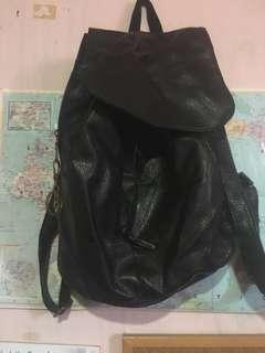 Plastic leather backpack