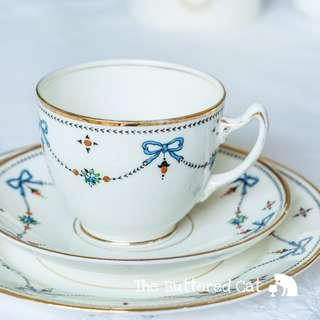 RESERVED Charming antique art deco English china trio, hand-decorated blue ribbon bows