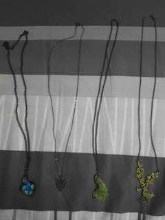 Four long chain necklaces (various pendants)
