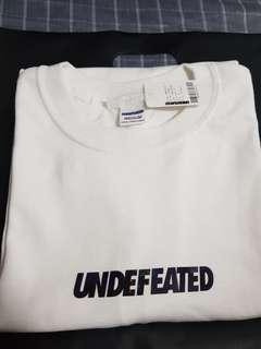 Undefeated holographic logo tee